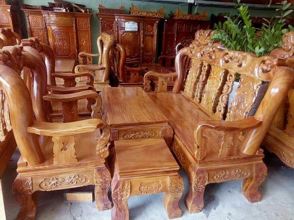 Bộ bàn ghế gỗ gõ đỏ để phòng khách chạm đào tay 12