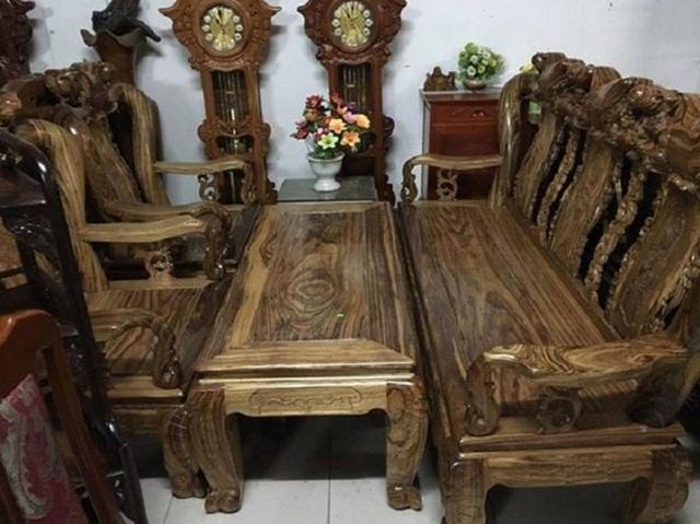 Bộ bàn ghế gỗ mun họa tiết quả đào